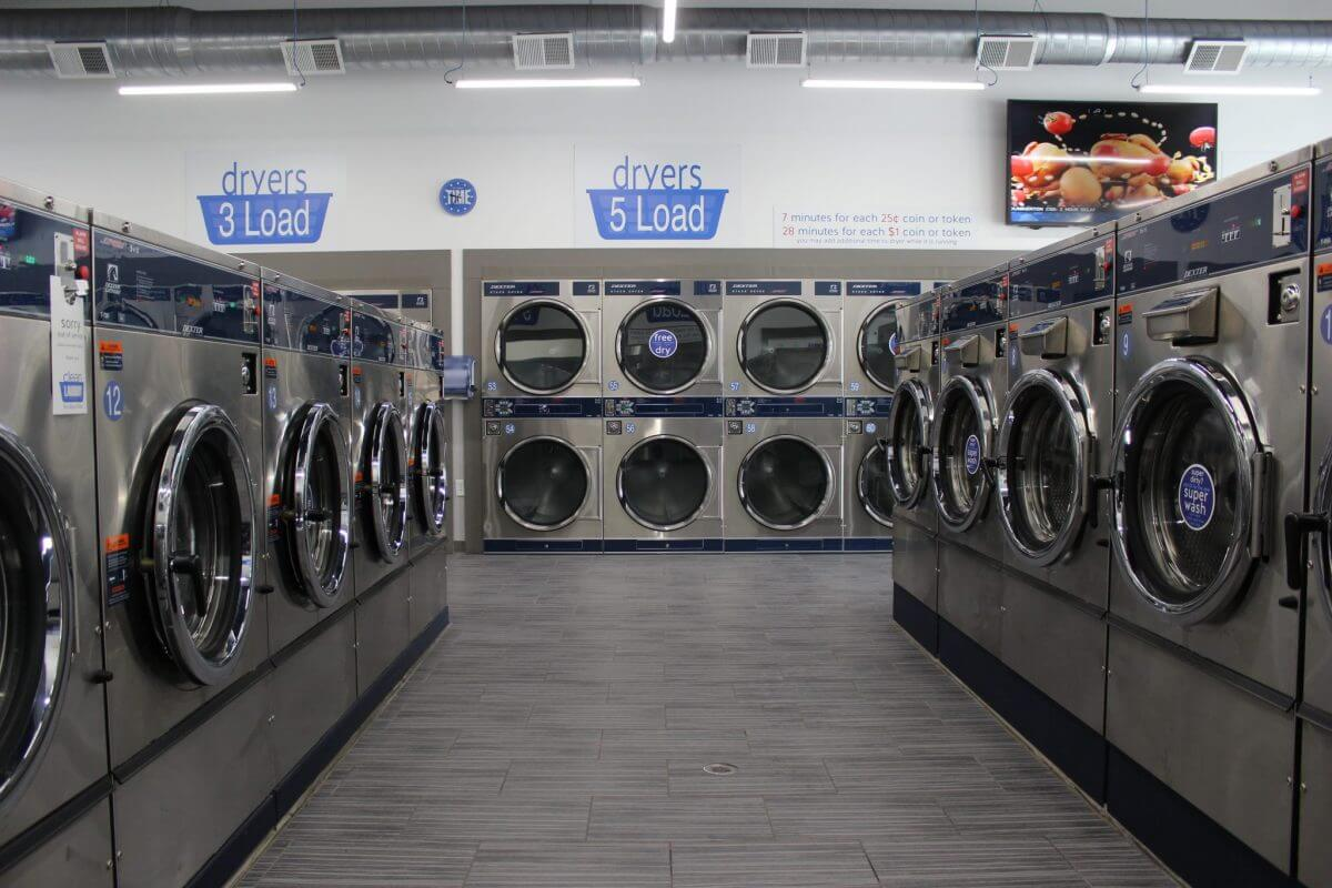 washing machines and dryers in clean laundry laundromat